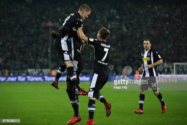 Matthias Ginter of Moenchengladbach celebrates with team mates after he scored a goal to make it 20 during the Bundesliga match between Borussia...