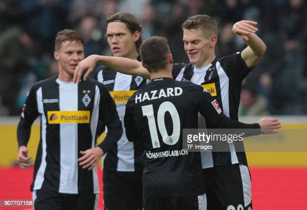 Matthias Ginter of Moenchengladbach celebrates with Thorgan Hazard of Moenchengladbach after scoring his team`s first goal during the Bundesliga...