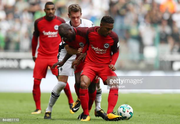 Matthias Ginter of Moenchengladbach fights for the ball with Jetro Willems and Jonathan de Guzman of Frankfurt during the Bundesliga match between...