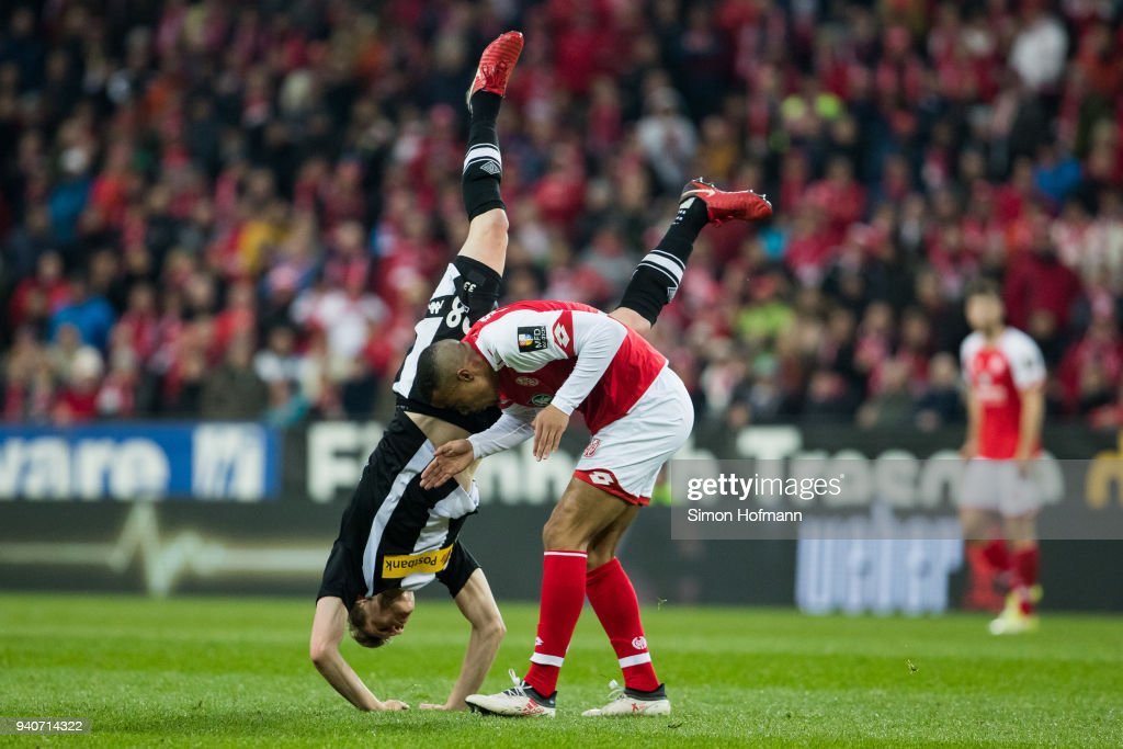 Matthias Ginter of Moenchengladbach is fouled by Robin Quaison of Mainz during the Bundesliga match between 1. FSV Mainz 05 and Borussia Moenchengladbach at Opel Arena on April 1, 2018 in Mainz, Germany.