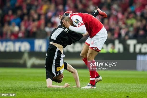 Matthias Ginter of Moenchengladbach is fouled by Robin Quaison of Mainz during the Bundesliga match between 1 FSV Mainz 05 and Borussia...