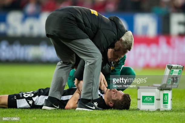 Matthias Ginter of Moenchengladbach is injured during the Bundesliga match between 1 FSV Mainz 05 and Borussia Moenchengladbach at Opel Arena on...