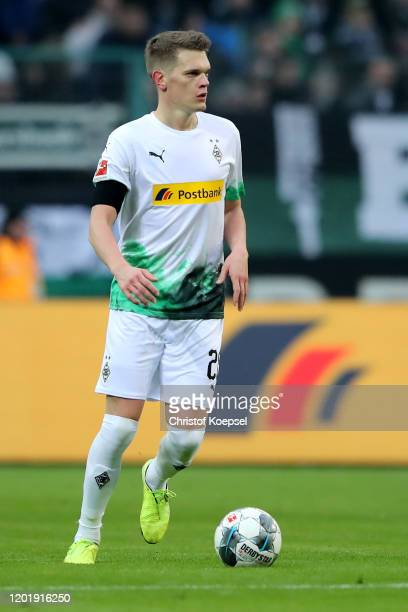 Matthias Ginter of Moenchengladbach runs with the ball during the Bundesliga match between Borussia Moenchengladbach and 1 FSV Mainz 05 at...