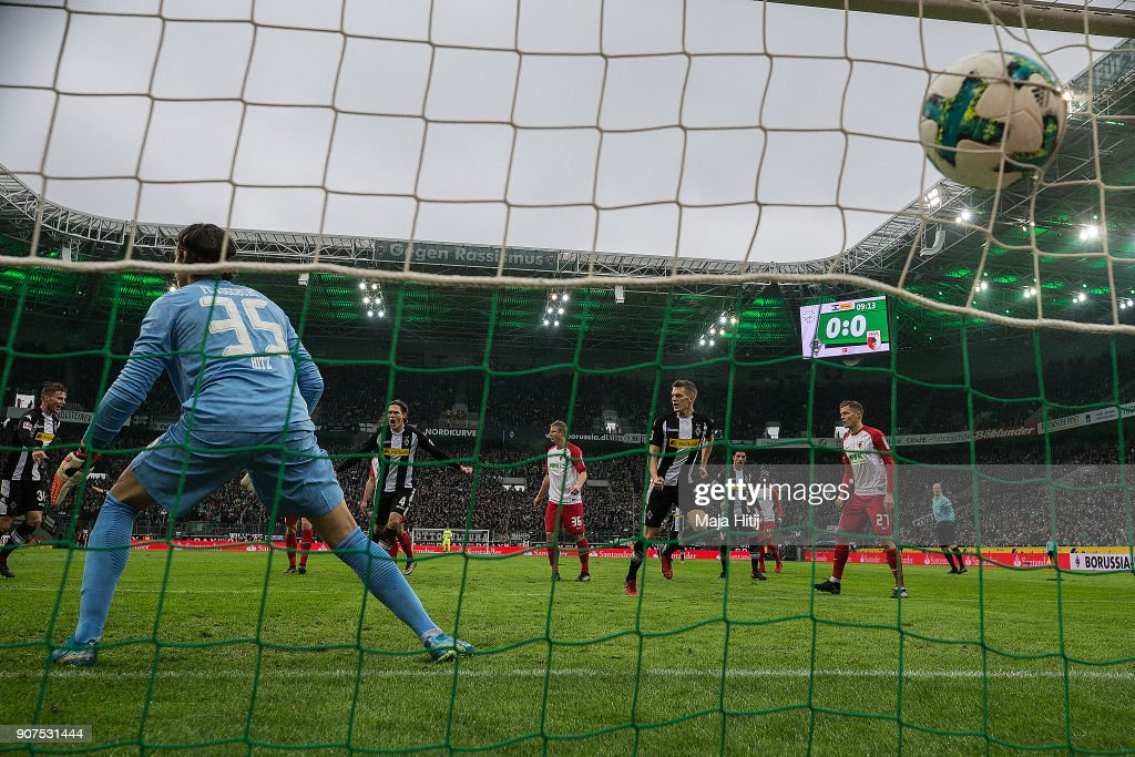 Matthias Ginter of Moenchengladbach (4th right) scores a goal past goalkeeper Yann Sommer of Moenchengladbach to make it 1:0 during the Bundesliga match between Borussia Moenchengladbach and FC Augsburg at Borussia-Park on January 20, 2018 in Moenchengladbach, Germany.