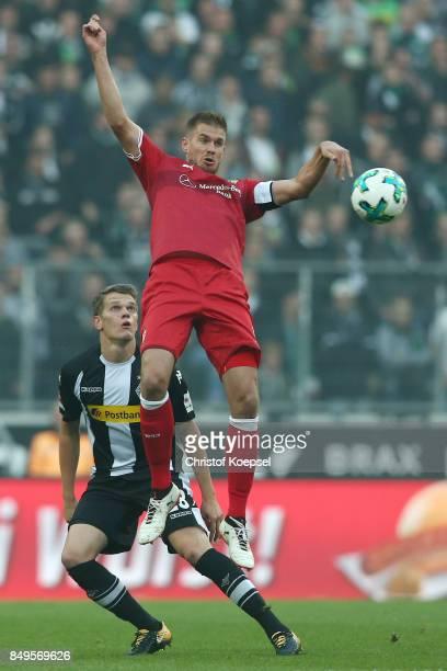 Matthias Ginter of Moenchengladbach with Simon Terodde of Stuttgart during the Bundesliga match between Borussia Moenchengladbach and VfB Stuttgart...
