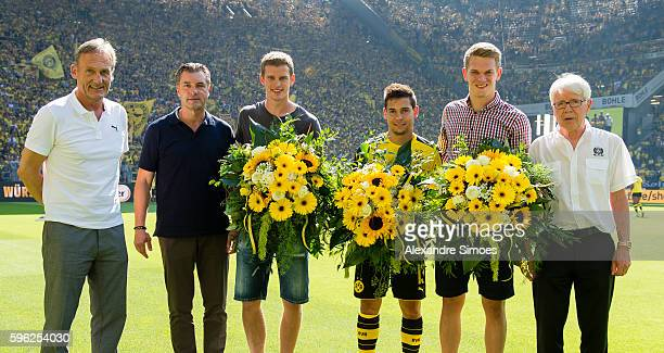 Matthias Ginter Raphael Guerreiro and Sven Benderof Borussia Dortmund is awarded by HansJoachim Watzke Dr Reinhard Rauball president of Borussia...