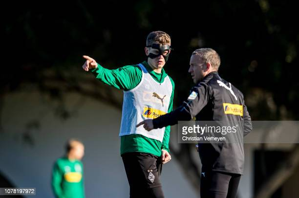 Matthias Ginter talks to Assistant Coach Frank Geideck during a training session at Borussia Moenchengladbach Training Camp on January 06, 2019 in...