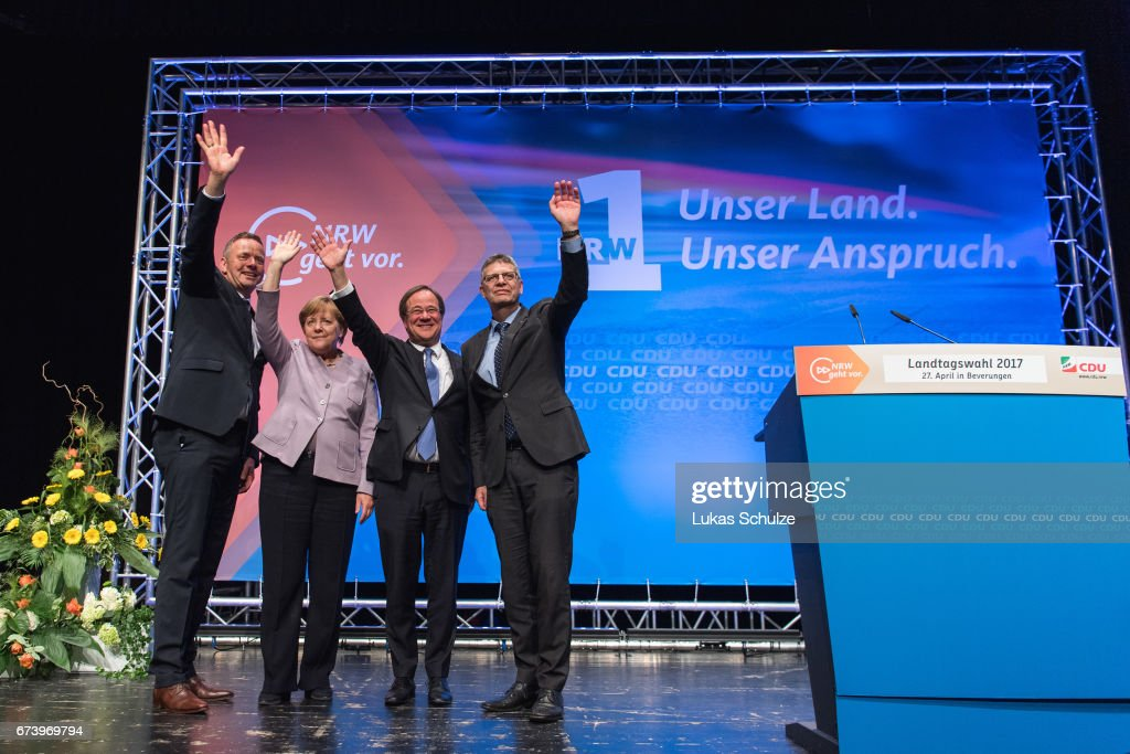 Matthias Goeken (L-R), German Chancellor and Chairwoman of the German Christian Democrats (CDU) Angela Merkel, local CDU lead candidate Armin Laschet and Christian Haase greet supporters at the opening CDU campaign rally for state elections in North Rhine-Westphalia on April 27, 2017 in Beverungen, Germany. North Rhine-Westphalia is Germany's most populous state and will hold state elections on May 14. According to a recent poll the CDU and the German Social Democrats (SPD) are in a tight race for the lead while the populist and right-wing Alternative for Germany (AfD) has slipped in polls to 8%.