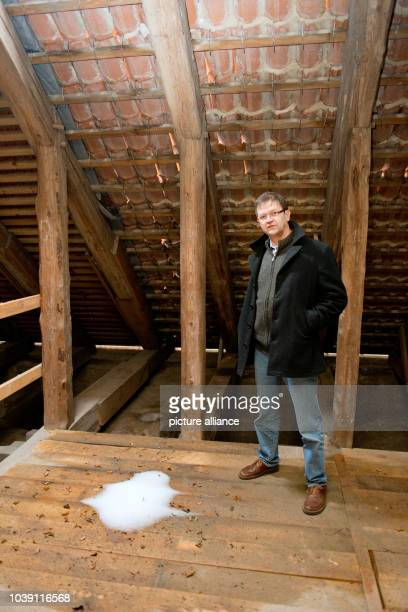 Matthias Guertler priest of the 700 year old Dom St Nikolai shows a crack in the brickwork in Greifswald Germany 29 January 2013 25 years ago the...