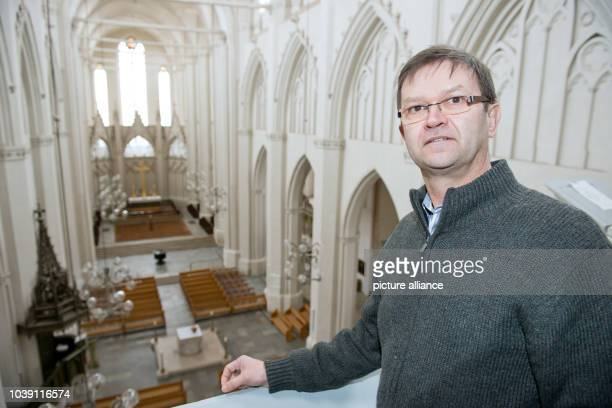 Matthias Guertler priest of the 700 year old 'Dom St Nikolai' stands in the central nave in Greifswald Germany 29 January 2013 25 years ago the...