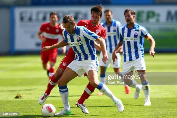 Matthias Holst of Rostock and Martin Harnik of Stuttgart battle for the ball during the friendly match between Hansa Rostock and VfB Stuttgart at DKB...