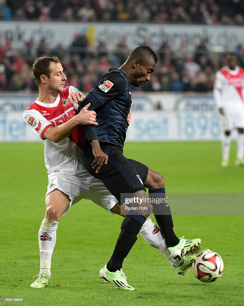 Matthias Lehmann of 1. FC Koeln and Salomon Kalou of Hertha BSC battle for the ball during the Bundesliga match between 1. FC Koeln and Hertha BSC at RheinEnergieStadion on November 22, 2014 in Cologne, Germany.