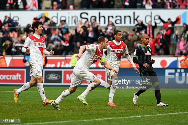 Matthias Lehmann of 1 FC Koeln celebrates as he scores the equalizing goal during the Bundesliga match between 1 FC Koeln and SV Werder Bremen at...