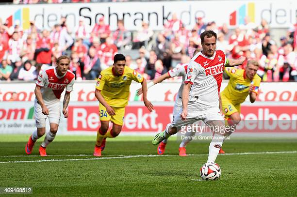 Matthias Lehmann of 1 FC Koeln scores the opening goal from a penalty during the Bundesliga match between 1 FC Koeln and 1899 Hoffenheim at...