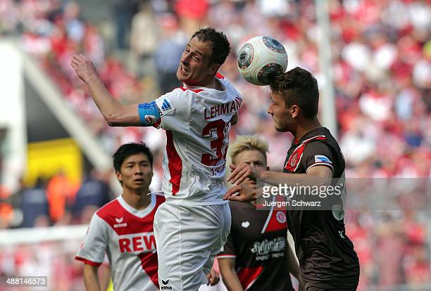 Matthias Lehmann of Cologne and Tom Trybull of Hamburg compete for the ball during the Second Bundesliga match between 1. FC Koeln and FC St. Pauli...