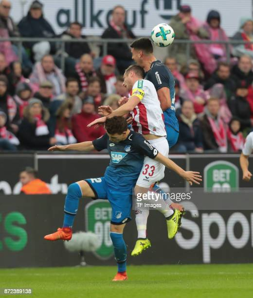 Matthias Lehmann of FC Koeln Dennis Geiger of Hoffenheim and Sandro Wagner battle for the ball during the Bundesliga match between 1 FC Koeln und TSG...