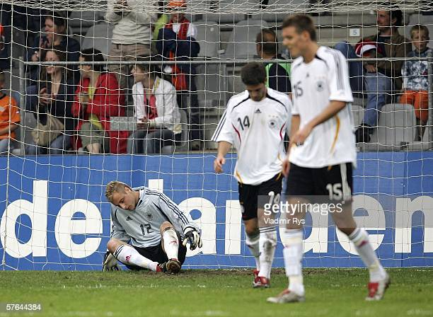 Matthias Lehmann of Germany and his team mates look dejected after receiving the 4th goal during the Men's Under 21 international friendly match...