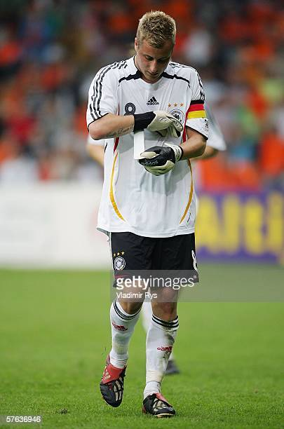 Matthias Lehmann of Germany puts on keeping hand gloves after his team mate goalkeeper Florian Fromlowitz receives a red card during the Men's Under...