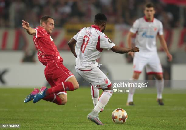 Matthias Lehmann of Koeln and Guelor Kanga of Belgrad battle for the ball during the UEFA Europa League group H match between 1 FC Koeln and Crvena...