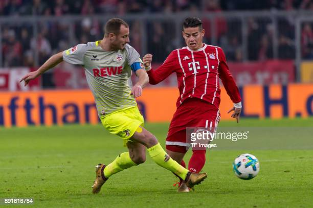 Matthias Lehmann of Koeln and James Rodriguez of Muenchen battle for the ball during the Bundesliga match between FC Bayern Muenchen and 1 FC Koeln...