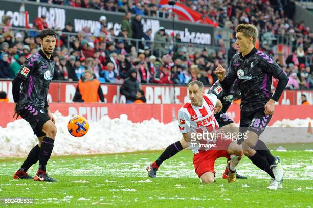 Matthias Lehmann of Koeln and Nils Petersen of Freiburg battle for the ball during the Bundesliga match between 1 FC Koeln and SportClub Freiburg at...
