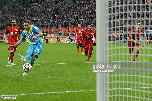 Matthias Lehmann of Koeln scores his team's opening goal by a penalty during the Bundesliga match between Bayer 04 Leverkusen and 1 FC Koeln at...
