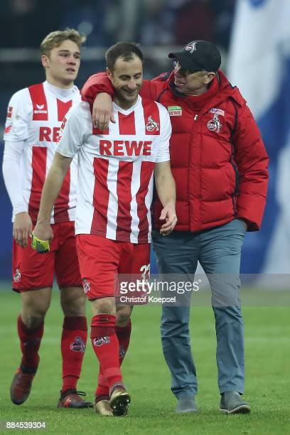 Matthias Lehmann of Koeln speaks with Peter Stoeger coach of Koeln after the Bundesliga match between FC Schalke 04 and 1 FC Koeln at VeltinsArena on...