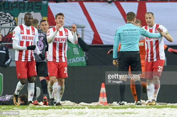 Matthias Lehmann of Koeln speaks with Referee Robert Kampka during the Bundesliga match between 1 FC Koeln and SportClub Freiburg at...