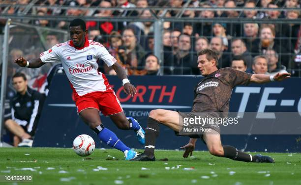 Matthias Lehmann of St Pauli and Eljero Elia of Hamburg battle for the ball during the Bundesliga match between FC St Pauli and Hamburger SV at...