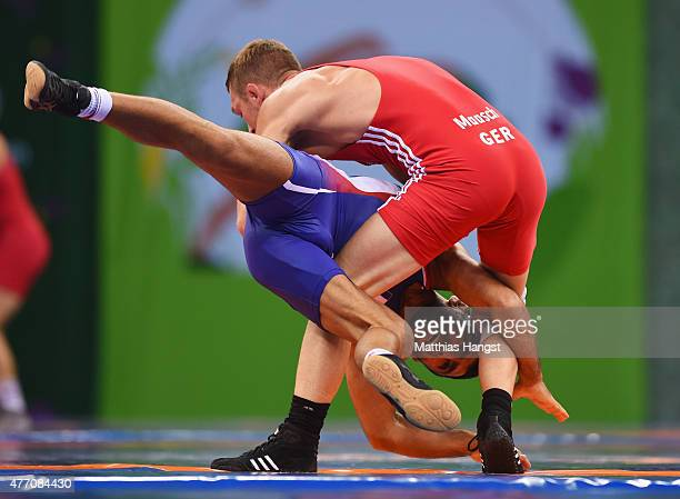 Matthias Maasch of Germany and Artak Margaryan of France compete in the Men's Wrestling 66kg Greco Roman 1/8 finals during day two of the Baku 2015...