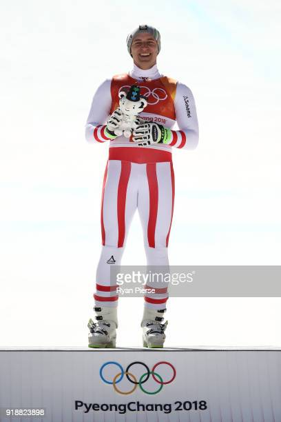 Matthias Mayer of Austria celebrates winning the gold medal on the podium following the Men's SuperG on day seven of the PyeongChang 2018 Winter...