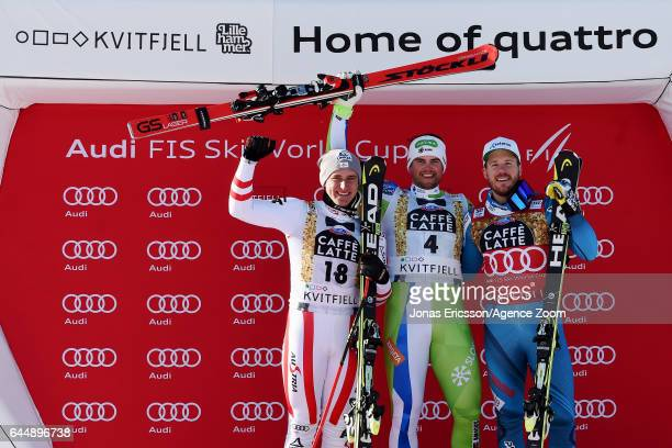 Matthias Mayer of Austria takes 2nd place, Bostjan Kline of Slovenia takes 1st place, Kjetil Jansrud of Norway takes 3rd place during the Audi FIS...