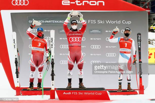 Matthias Mayer of Austria takes 2nd place, Vincent Kriechmayr of Austria takes 1st place, Marco Odermatt of Switzerland takes 3rd place during the...