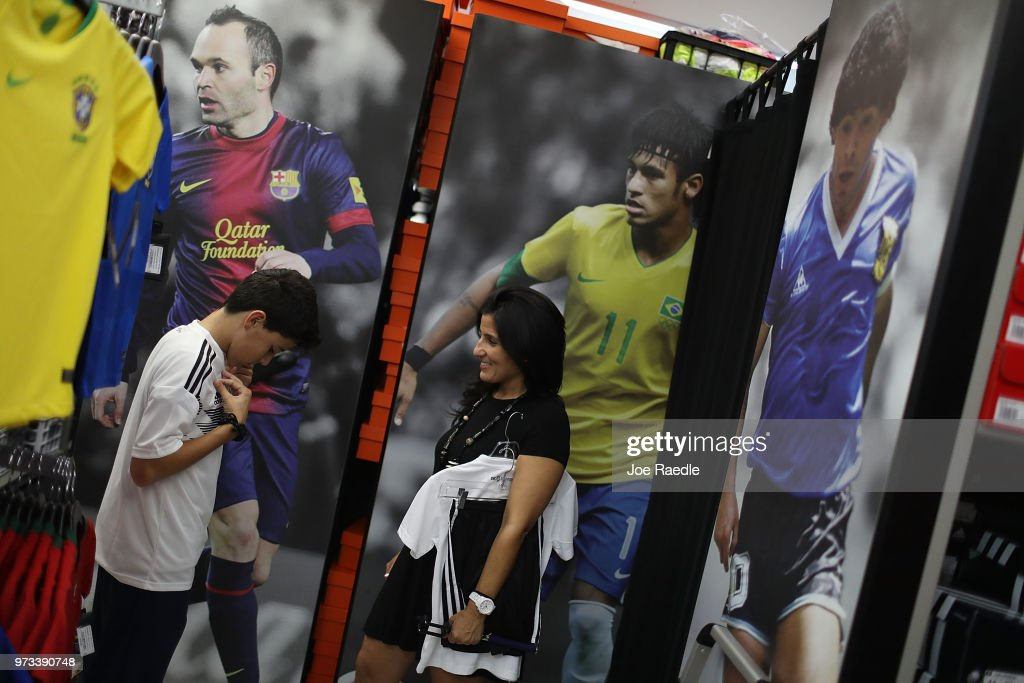 Matthias Meyer and his mother Vanessa Meyer shop at the Soccer Locker store for German soccer team items as they prepare to show their support for their favorite World Cup soccer team that is in the tournament being held in Russia on June 13, 2018 in Miami, Florida. As the world prepares for the kickoff of the World Cup soccer tournament tomorrow, FIFA announced today that North America will host the tournament in 2026.