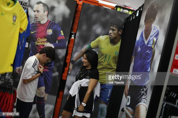 Matthias Meyer and his mother Vanessa Meyer shop at the Soccer Locker store for German soccer team items as they prepare to show their support for...