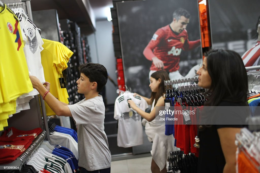 Matthias Meyer, Mia Meyer and their mother Vanessa Meyer shop at the Soccer Locker store for German soccer team items as they prepare to show their support for their favorite World Cup soccer team that is in the tournament being held in Russia on June 13, 2018 in Miami, Florida. As the world prepares for the kickoff of the World Cup soccer tournament tomorrow, FIFA announced today that North America will host the tournament in 2026.