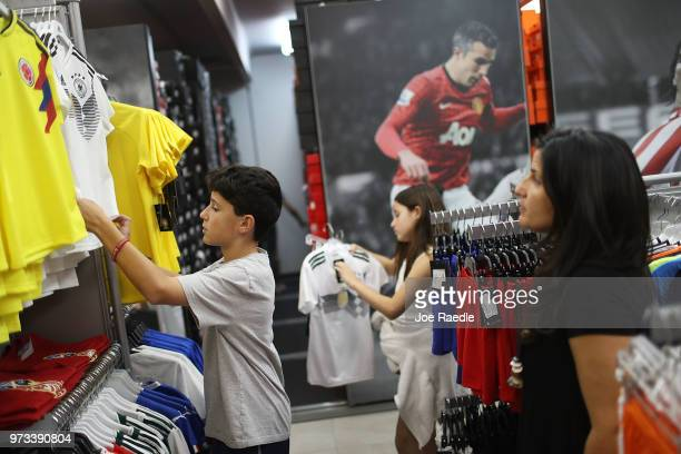 Matthias Meyer Mia Meyer and their mother Vanessa Meyer shop at the Soccer Locker store for German soccer team items as they prepare to show their...
