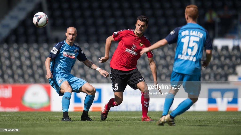 Matthias Morys of Aalen (L) is challenged by Julian Leist of Grossaspach during the 3. Liga match between SG Sonnenhof Grossaspach and VfR Aalen at on August 19, 2017 in Grossaspach, Germany.