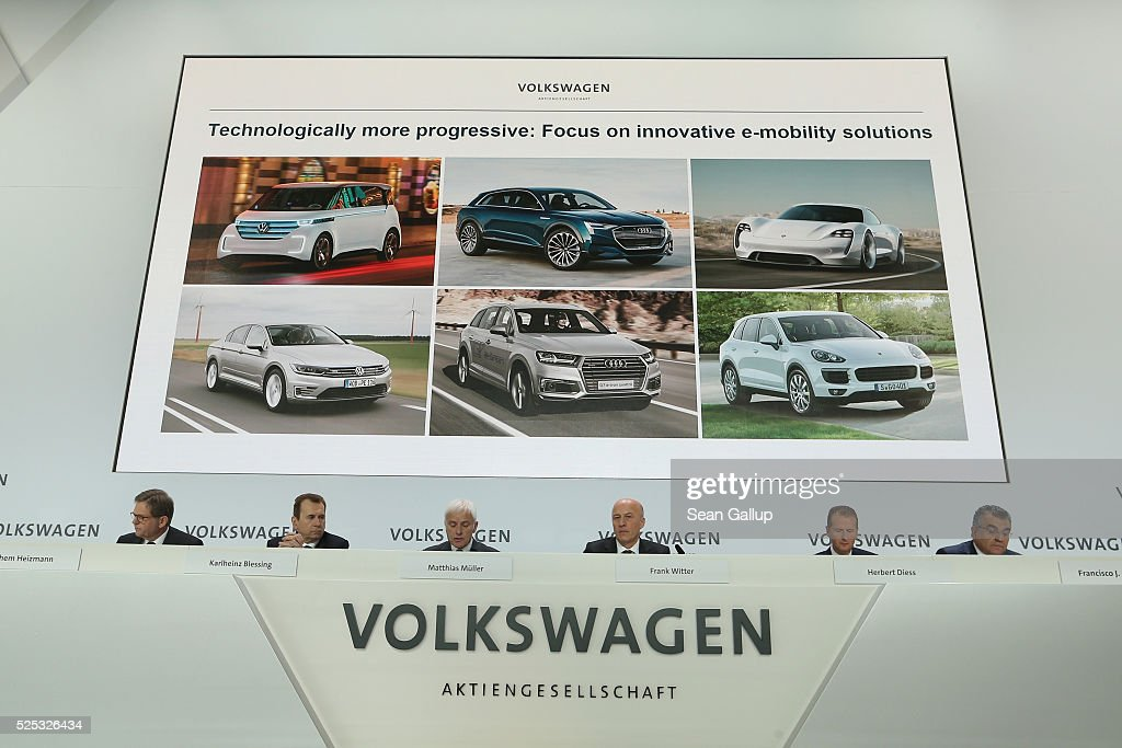Matthias Mueller (C-L), CEO of German automaker Volkswagen AG, speaks at the company's annual press conference on April 28, 2016 in Wolfsburg, Germany. Volkswagen is facing high costs and stiff penalties, including the possible buyback of up to 500,000 cars it sold in the USA, as a reult of VW's diesel emissions scandal.