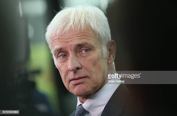 Matthias Mueller CEO of German automaker Volkswagen AG speaks to television reporters following the company's annual press conference on April 28...