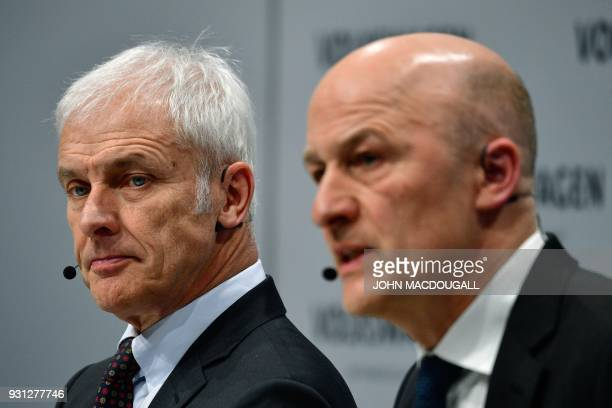 Matthias Mueller CEO of German car maker Volkswagen and VW CFO Frank Witter attend their company's annual press conference in Berlin on March 13 2018...
