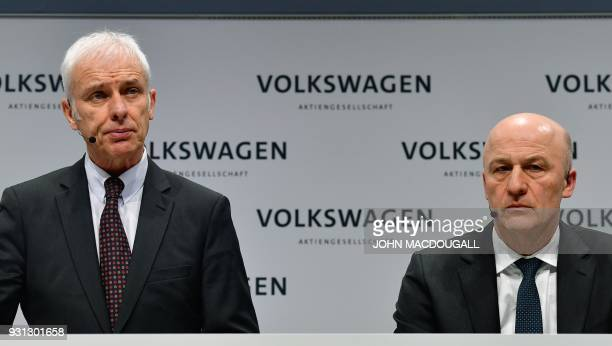Matthias Mueller CEO of German car maker Volkswagen and VW's CFO Frank Witter attend their company's annual press conference in Berlin on March 13...