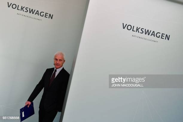 Matthias Mueller CEO of German car maker Volkswagen arrives for his company's annual press conference in Berlin on March 13 2018 Volkswagen holds its...