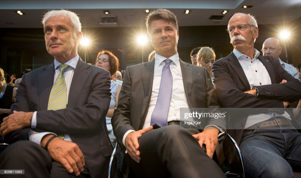 Matthias Mueller (l-r), CEO of German car maker Volkswagen, Harald Krueger, CEO of German car maker BMW and Dieter Zetsche, chairman of German car maker Daimler AG and head of Mercedes-Benz cars attend a press conference in the course of the Diesel Summit on August 02, 2017 in Berlin, Germany. Representatives of the automobile industry and federal politics meet to find solutions in reducing the pollutant emissions of diesel vehicles.