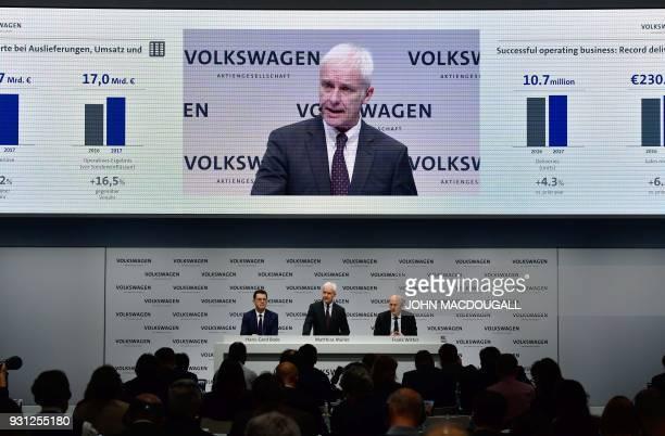 Matthias Mueller CEO of German car maker Volkswagen is flanked by VW's CFO Frank Witter and board member HansGerd Bode as he speaks during his...