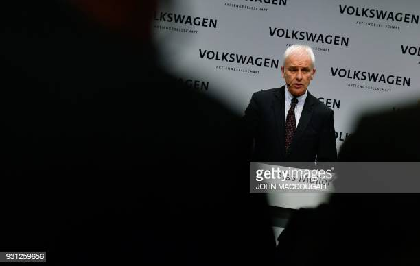 Matthias Mueller CEO of German car maker Volkswagen speaks during his company's annual press conference in Berlin on March 13 2018 Volkswagen holds...