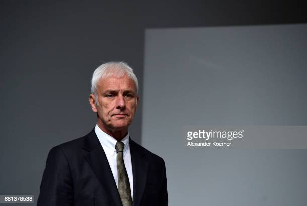 Matthias Mueller CEO of German carmaker Volkswagen AG arrives for the company's annual general shareholders meeting on May 10 2017 in Hanover Germany...