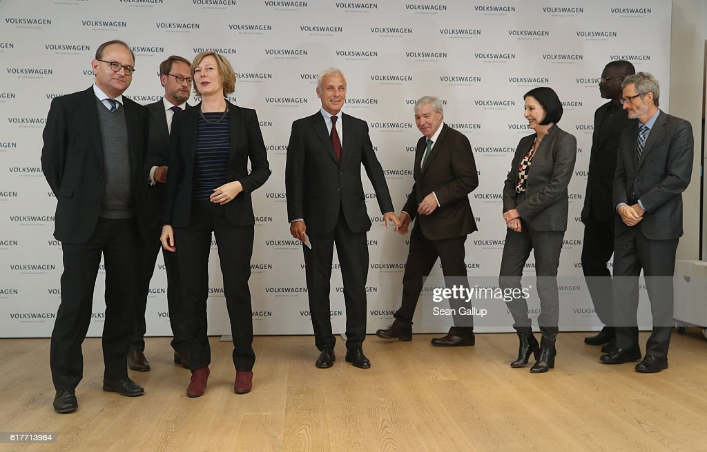 Matthias Mueller (C, 5th from R), CEO of German carmaker Volkswagen AG, arrives with members of the company's new sustainability council: (from L to R) Ottmar Edenhofeer, Gesche Joost, Michael Sommer, unidentified, Elhadj As Sy and Georg Kell following the council's first meeting on October 24, 2016 in Berlin, Germany. The council will advice Volkswagen on environmental and social responsibility. The company is still dealing with the consequences that it had installed cheating software in millions of its diesel-powered cars to fool environmental regulators. The affected cars emitted legal levels of noitrogen oxide pollutants under testing conditions only. In actual use the cars spewed out levels up to 40 times higher.