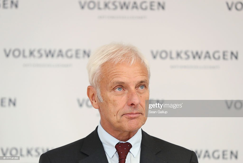 Matthias Mueller (C, 5th from R), CEO of German carmaker Volkswagen AG, speaks at an event to present the company's new sustainability council following the council's first meeting on October 24, 2016 in Berlin, Germany. The council will advice Volkswagen on environmental and social responsibility. The company is still dealing with the consequences that it had installed cheating software in millions of its diesel-powered cars to fool environmental regulators. The affected cars emitted legal levels of noitrogen oxide pollutants under testing conditions only. In actual use the cars spewed out levels up to 40 times higher.