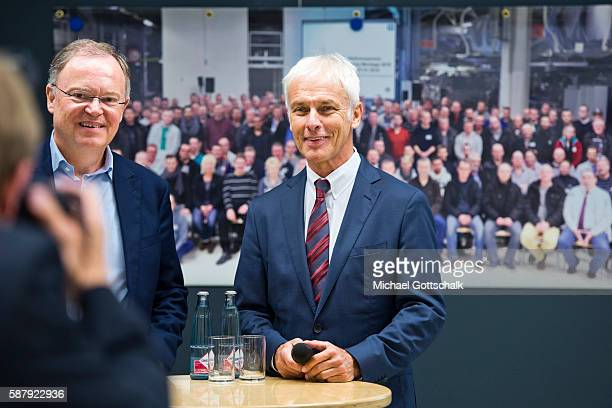 Matthias Mueller CEO of Volkswagen AG and Stephan Weil Prime Minister of German State LowerSaxony attend a visit to the production facility for Golf...
